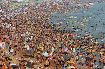 People play on a beach in Qingdao